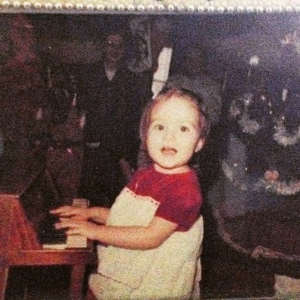 """That is two year old me """"performing"""" for my sweet grandmother on my very first tiny piano.  That crushed red velvet is definitely Elton style."""
