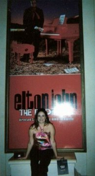 Yours truly in front of the concert poster in Vegas in 2006.  It was a trip with my Mom and Dad, and one of the best days of my life.